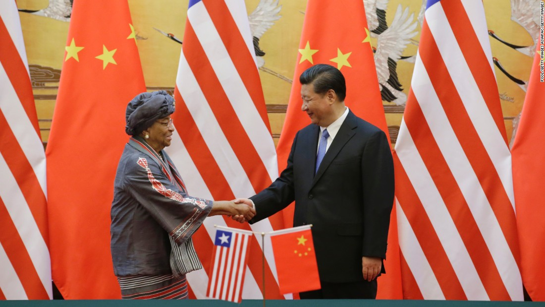China's President Xi Jinping (R) shakes hands with Liberia's President Ellen Johnson-Sirleaf after a signing ceremony at the Great Hall of the People on November 3, 2015 in Beijing, China.  The meeting was aimied at promoting bilateral relations.  Liberia was one of the only African countries to recognize both the People's Republic of China (PRC) and the Republic of China (Taiwan), though later cut ties with Taiwan under pressure from the PRC.