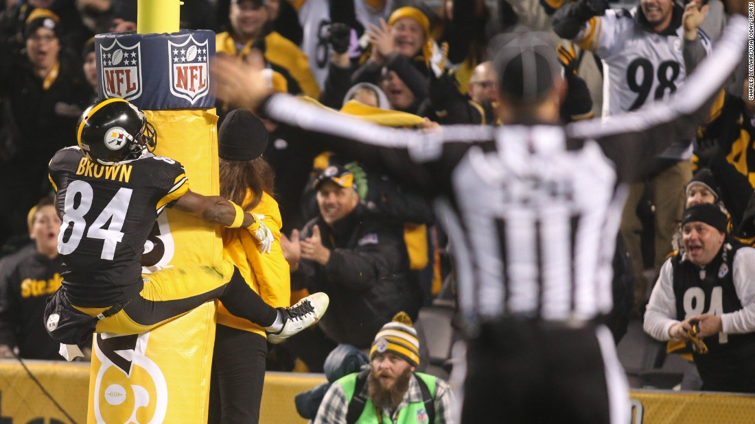 Pittsburgh Steelers wide receiver Antonio Brown jumps on a goal post as he celebrates a punt-return touchdown on Sunday, December 6. Brown also had two receiving touchdowns as the Steelers trounced Indianapolis 45-10 in Pittsburgh.