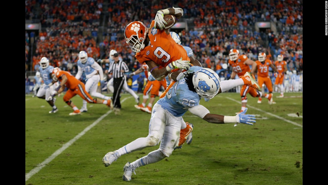 Clemson's Wayne Gallman evades North Carolina's Dominique Green during the ACC Championship game on Saturday, December 5. Clemson won the game 45-37 to clinch a spot in the four-team College Football Playoff.