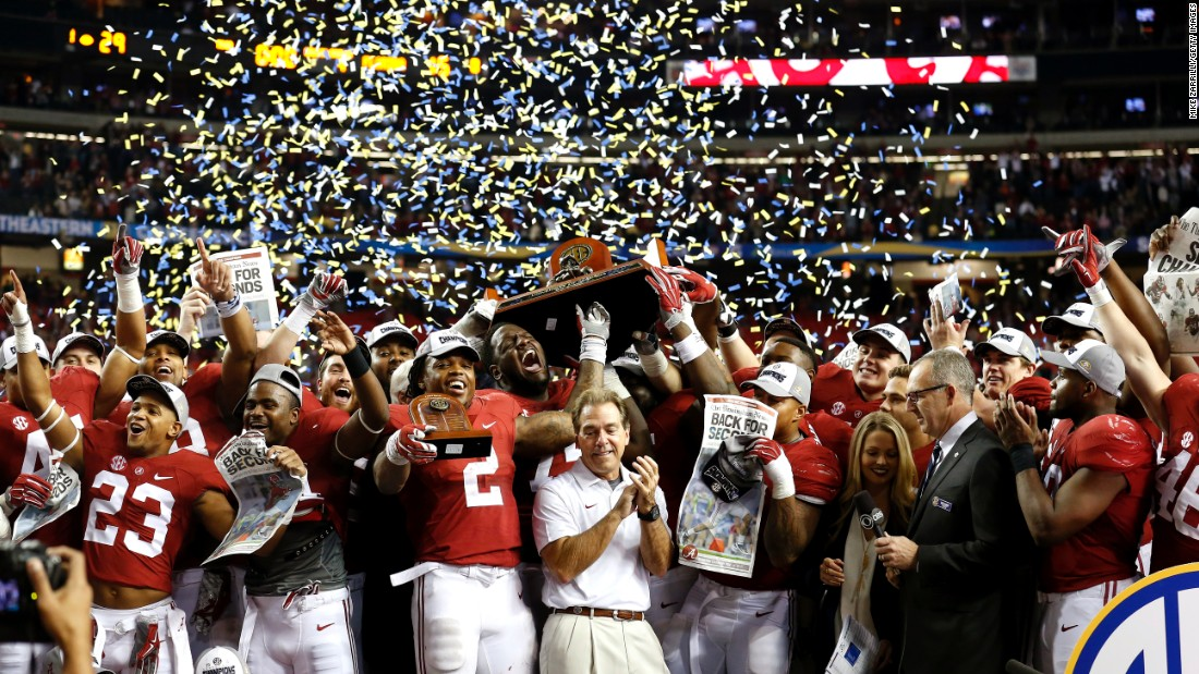 Alabama's football team celebrates its 29-15 victory over Florida in the SEC Championship game on Saturday, December 5. Alabama will join Clemson, Michigan State and Oklahoma in the College Football Playoff.