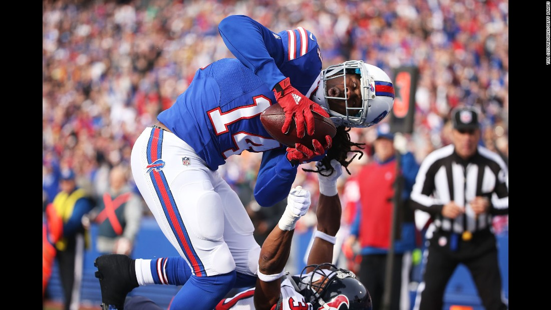 Buffalo wide receiver Sammy Watkins scores a touchdown as he's defended by Houston's Kevin Johnson during an NFL game in Orchard Park, New York, on Sunday, December 6. Watkins had three catches for 109 yards as Buffalo won 30-21.