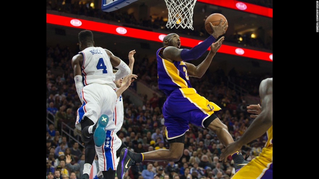 Kobe Bryant lays the ball in during an NBA game in Philadelphia on Tuesday, December 1. The home team defeated Bryant's Lakers, however, for its first victory of the season. The 76ers had begun the season 0-18, tying the worst start in NBA history.