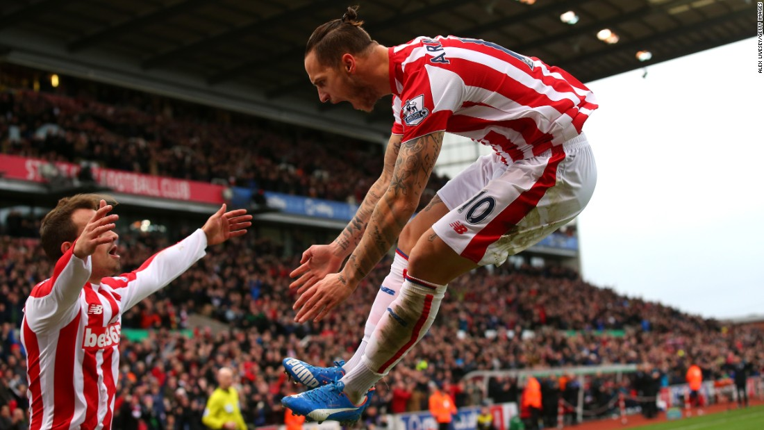 Stoke City's Marko Arnautovic, right, celebrates one of the two goals he scored against Manchester City during a 2-0 victory Saturday, December 5, in Stoke-on-Trent, England.