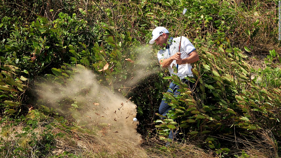 Sergio Garcia plays a shot from a tricky lie Friday, December 4, during an Asian Tour event in Ho Chi Minh City, Vietnam. Garcia eventually won the Ho Tram Open in a four-way playoff.