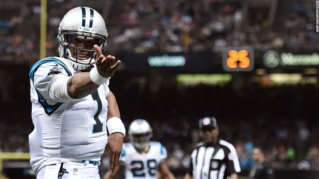 Cam Newton celebrates a touchdown during the Carolina Panthers' 41-38 victory in New Orleans on Sunday, December 6. Newton threw five touchdowns for the Panthers, who are the NFL's only undefeated team this season (12-0).