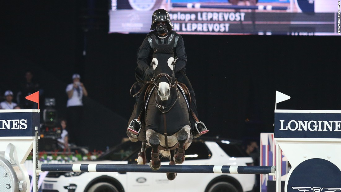 Penelope Leprevost wears a Darth Vader costume during a charity show-jumping event in Villepinte, France, on Saturday, December 5.