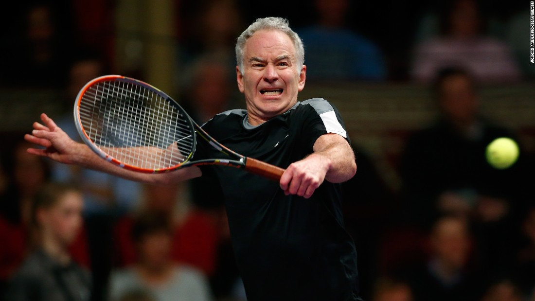 Tennis great John McEnroe plays a backhand shot while taking on Tim Henman in London on Saturday, December 5.