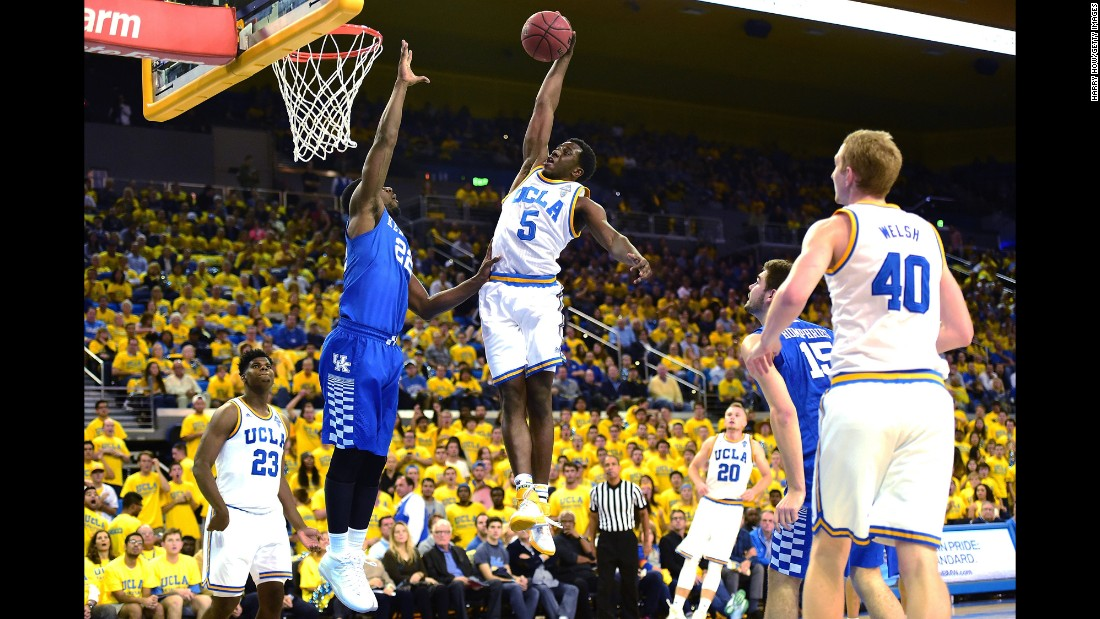 UCLA's Prince Ali dunks over Kentucky's Alex Poythress during a college basketball game in Los Angeles on Thursday, December 3. UCLA upset the top-ranked Wildcats 87-77.