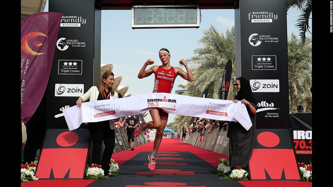 "Swiss triathlete Daniela Ryf celebrates after winning the Ironman race in Bahrain on Saturday, December 5. The victory <a href=""http://www.220triathlon.com/news/daniela-ryf-wins-million-dollar-triple-crown-at-ironman-703-bahrain/10680.html"" target=""_blank"">gave her $1 million</a> because she won each race in the Nasser Bin Hamad Triple Crown."