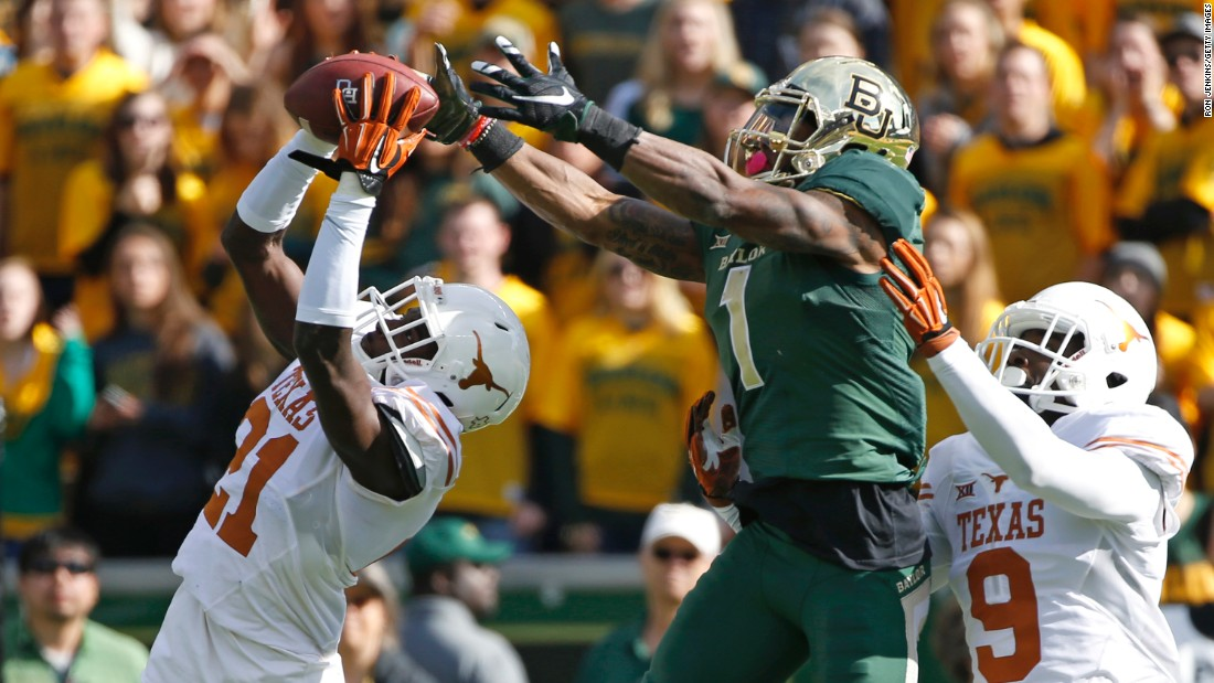 Texas' Duke Thomas intercepts a ball against Baylor during a college football game in Waco, Texas, on Saturday, December 5.