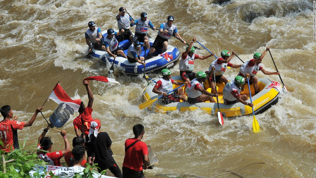 A team from Indonesia, right, competes against a team from Slovakia during the World Rafting Championships on Friday, December 4. The race took place on the Citarik River in Sukabumi, Indonesia.