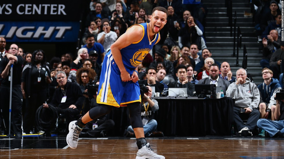 Stephen Curry sticks his tongue out during an NBA game in New York on Sunday, December 6. Curry and the Golden State Warriors beat the Brooklyn Nets 114-98, improving their record this season to 22-0. It's the best start ever to an NBA season.