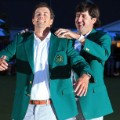 Bubba Watson hands Adam Scott Green Jacket