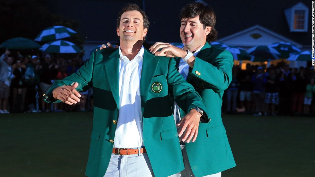 The left-hander struggled to a tie for 50th on his return to Augusta as defending champion, but he was on hand to present 2013 champion Adam Scott with his first green jacket.