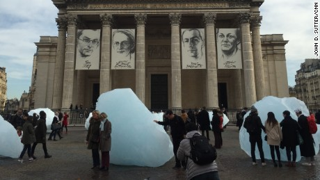 An artist brought tons of ice from Greenland to Paris to raise awareness about climate change.