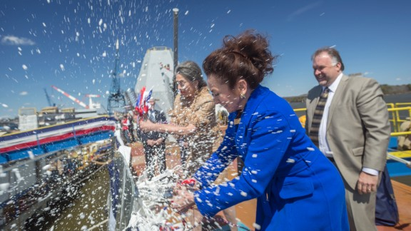 Mouzetta Zumwalt-Weathers christens the Zumwalt during a ceremony at Bath Iron Works on April 12, 2014.