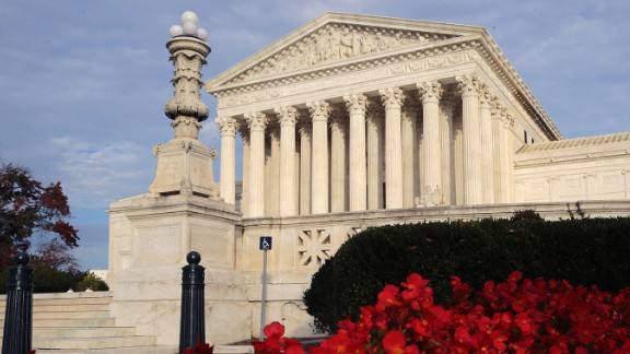 Flowers bloom in front of The United States Supreme Court building November 6, 2015 in Washington, DC.