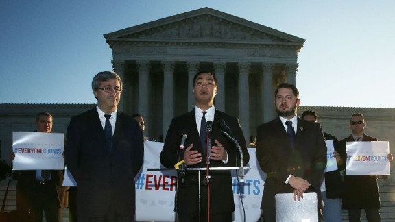 U.S. Rep. Joaquin Castro (D-TX) (C) speaks as Rep. Ruben Gallego (D-AZ) (R) and Mexican American Legal Defense and Education Fund President and General Counsel Thomas Saenz (L) listen during a news conference in front of the Supreme Court December 8, 2015 in Washington, DC.