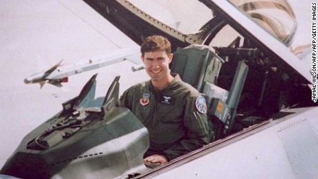 In a 1995 photo, the pilot sits in an F-16 similar to the one he was flying over Bosnia.