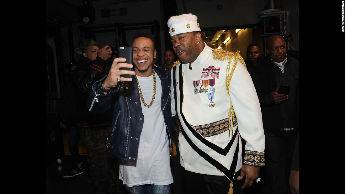 Rapper Busta Rhymes, right, poses for a backstage photo at a concert in Newark, New Jersey, on Saturday, December 5.