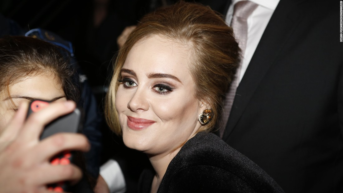 Singer Adele greets fans in Milan, Italy, after a television appearance on Friday, December 4.