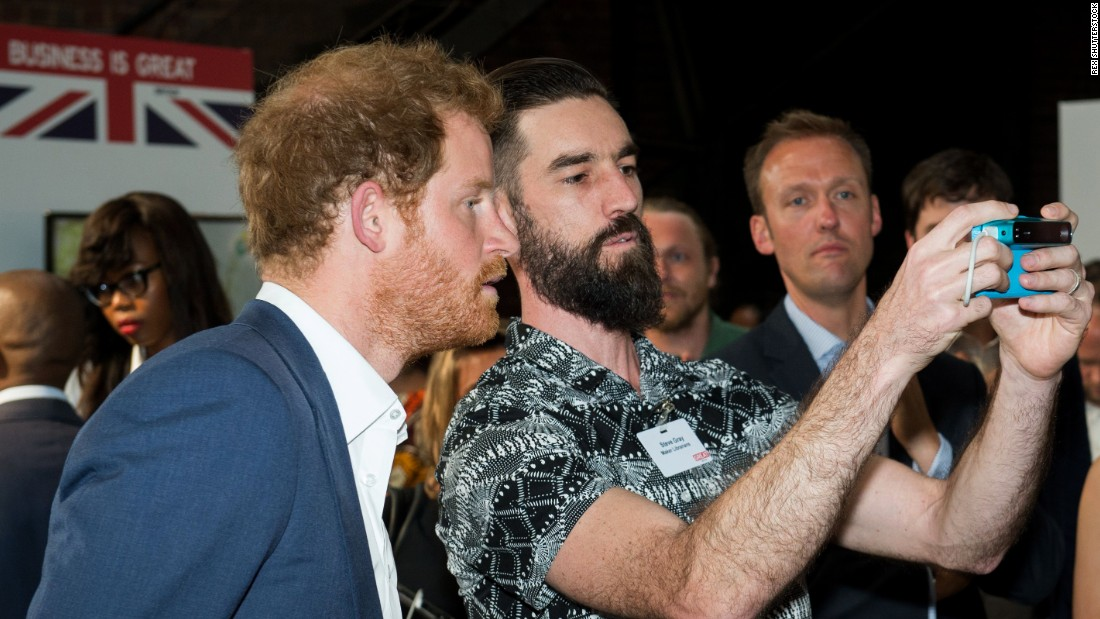 "Prince Harry might be <a href=""http://www.cnn.com/videos/us/2015/04/06/erin-pkg-moos-royal-selfie-ban.cnn"" target=""_blank"">anti-selfie,</a> but the British royal takes one here at a youth empowerment event in Johannesburg on Thursday, December 3."