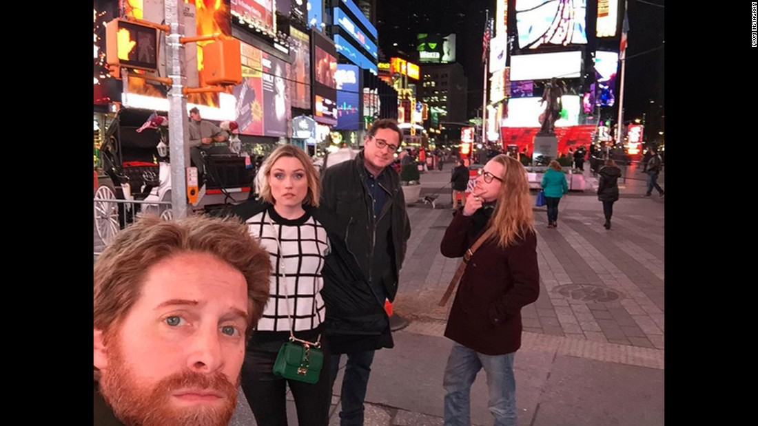 "Actor Seth Green takes a selfie in New York's Times Square on Thursday, December 3. Behind Green, from left, are his wife, actress Clare Grant; comedian Bob Saget; and actor Macaulay Culkin. Saget posted this <a href=""https://www.instagram.com/p/-1u4o6zP_l/?taken-by=bobsaget"" target=""_blank"">to his Instagram account. </a>"