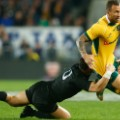 Quade Cooper fends off Dan Carter