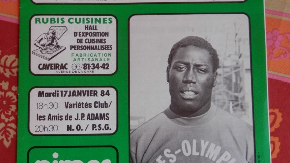 A program showing a match organized by Adams' former club Nîmes in aid of the footballer in 1984, two years after his accident.