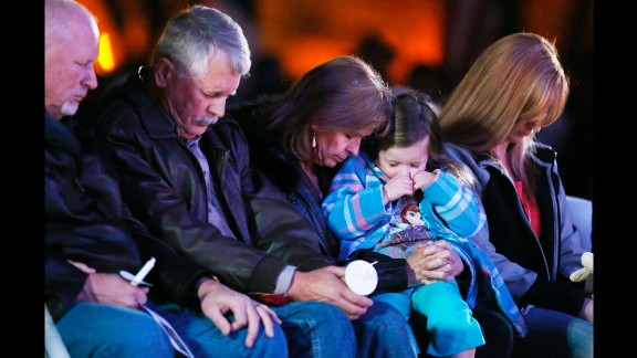 Carl Mueller, second from left, sits next to his wife, Marsha, as they honor their daughter Kayla with a candlelight vigil in Prescott, Arizona, on Wednesday, February 18. Kayla, a 26-year-old American aid worker, was killed by the militant group ISIS. She had been captured in northern Syria in 2013.