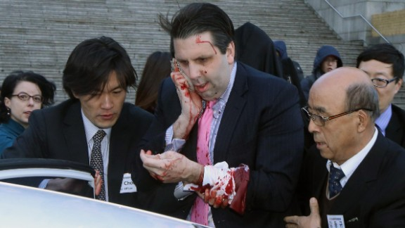 Mark Lippert, the U.S. ambassador to South Korea, leaves for a hospital after he was attacked Thursday, March 5, in Seoul, South Korea. According to Seoul police, Lippert was slashed on his right cheek and hand with a knife measuring about 10 inches long. The attacker, Kim Ki-Jong, was convicted of attempted murder in September and sentenced to 12 years in prison.