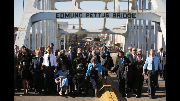 President Barack Obama, on the left in the white shirt, and former President George W. Bush, on the far right, march across the Edmund Pettus Bridge in Selma, Alabama, on Saturday, March 7. Their wives also joined them for the event, which was held 50 years after marchers were brutally beaten as they demonstrated for voting rights.