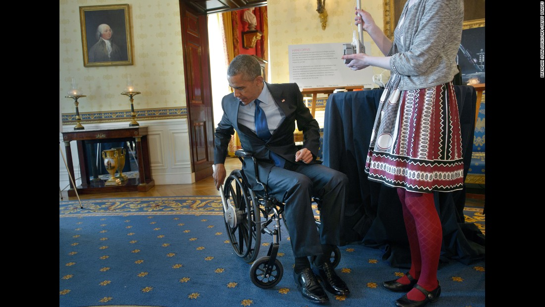 President Obama tries a wheelchair designed by student Kaitlin Reed during the White House Science Fair on Monday, March 23. A rowing motion powers the wheelchair.