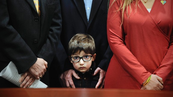 Hayden Lewis, cousin of Sandy Hook shooting victim Jesse Lewis, stands with his family during a news conference in Hartford, Connecticut, on Monday, April 13. Connecticut