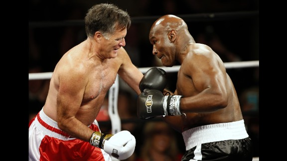 Former presidential candidate Mitt Romney, left, boxes former heavyweight champion Evander Holyfield during a charity event Friday, May 15, in Salt Lake City. The bout raised money for CharityVision, an organization that provides surgeries to heal blindness.
