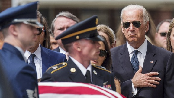 Vice President Joe Biden places his hand over his heart as the casket of his late son, former Delaware Attorney General Beau Biden, is carried into a church in Wilmington, Delaware, for a funeral on Saturday, June 6. Beau Biden died of brain cancer at the age of 46.