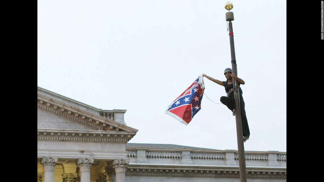 "Bree Newsome <a href=""http://www.cnn.com/2015/06/27/politics/south-carolina-confederate-flag/"" target=""_blank"">removes the Confederate battle flag</a> from a monument in front of the South Carolina State House on Saturday, June 27. She was charged with defacing a monument, and a new flag went up within about an hour, according to the South Carolina Department of Public Safety. Not long after she was led away in handcuffs, Newsome became an online hero, a trending topic on social media and the subject of an online fundraiser. South Carolina took down the flag on its own in July, <a href=""http://www.cnn.com/2015/07/10/us/south-carolina-confederate-battle-flag/"" target=""_blank"">ending a 54-year run</a> on the Capitol grounds."