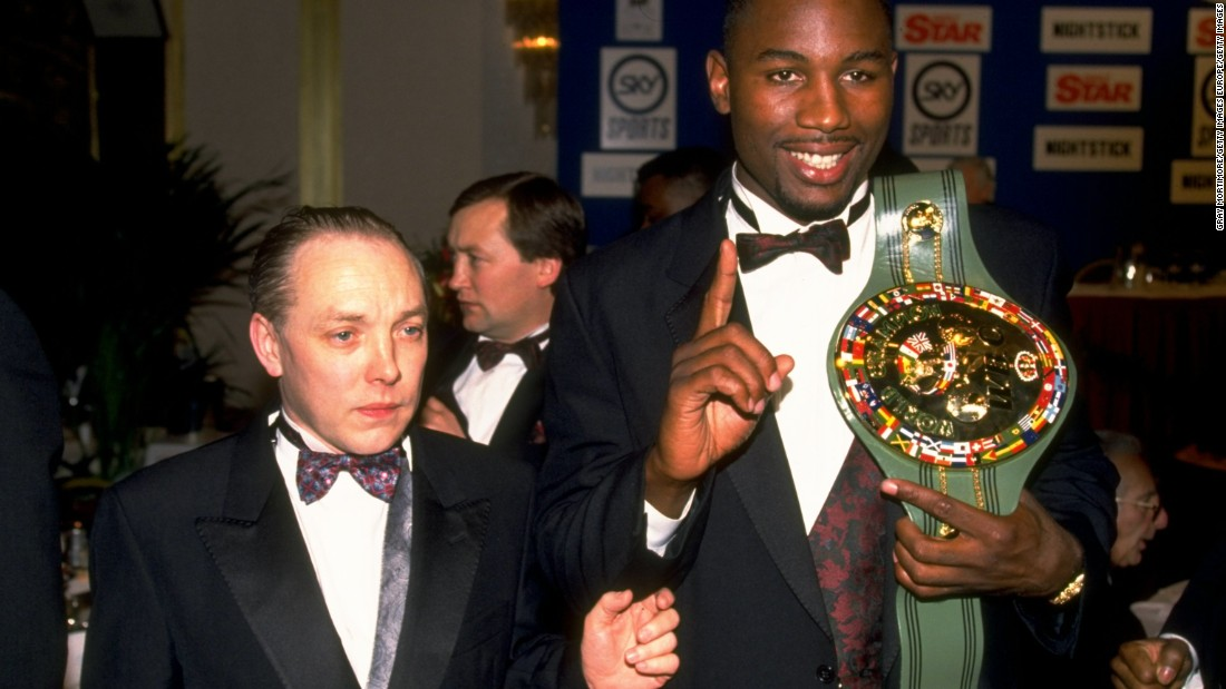 Lewis shows off his WBC belt alongside manager Maloney in 1992.