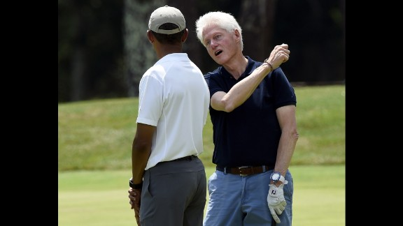 President Obama plays golf with former President Bill Clinton during his vacation to Martha