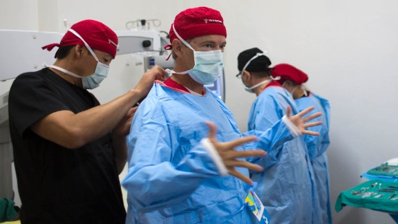 U.S. Sen. Rand Paul, the Republican presidential candidate from Kentucky who is also an ophthalmologist, gets suited up so he can perform cataract surgery in Haiti on Monday, August 17. While the humanitarian trip was not technically part of Paul