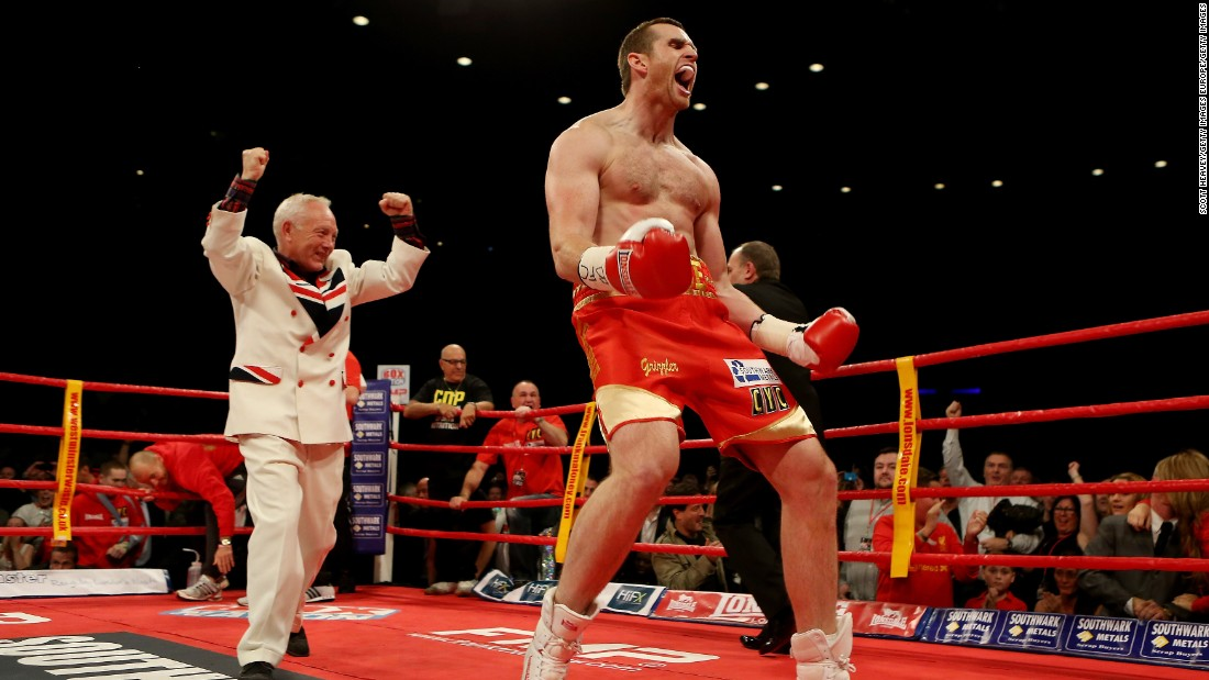 Maloney and boxer David Price celebrate winning against  Audley Harrison after their British and Commonwealth heavyweight championships bout in 2012.