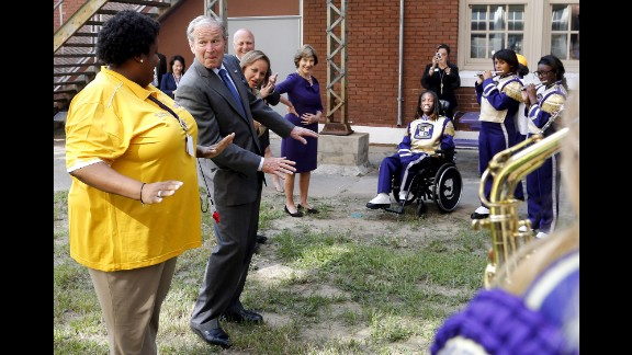 Former President George W. Bush dances along with the Warren Easton High School marching band during a trip to New Orleans on Friday, August 28. Bush