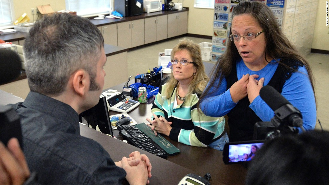 "Rowan County Clerk Kim Davis, right, talks with David Moore after she refused him a marriage license in Morehead, Kentucky, on Tuesday, September 1. Davis <a href=""http://www.cnn.com/2015/09/14/politics/kim-davis-same-sex-marriage-kentucky/index.html"" target=""_blank"">was eventually jailed</a> for refusing to issue marriage licenses to same-sex couples. She said same-sex marriages violated her Christian beliefs. After her release, she said she would not issue any marriage licenses that go against her religious beliefs. But she left the door open for her deputies to give out marriage licenses to same-sex couples as long as those documents do not have her name or title on them."
