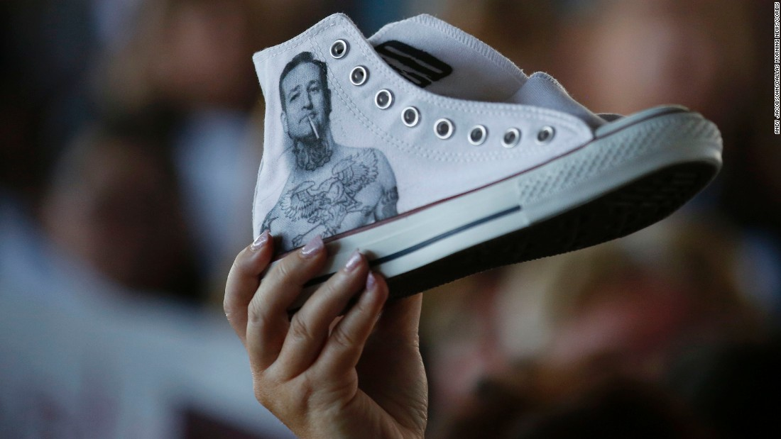 A supporter of Republican presidential candidate Ted Cruz holds up a sneaker with the U.S. senator's likeness on it while Cruz campaigns in Fort Worth, Texas, on Thursday, September 3.