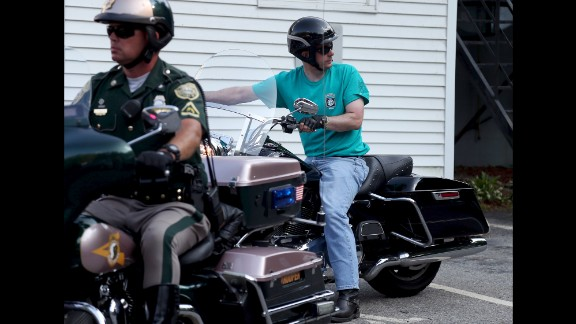 Wisconsin Gov. Scott Walker rides a motorcycle as he arrives at an Elk