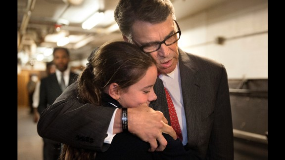 Former Texas Gov. Rick Perry embraces Madeline Martin, daughter of Eagle Forum President Ed Martin, before speaking at the Eagle Council XLIV in St. Louis on Friday, September 11. During his speech, Perry became the first major presidential candidate to drop out of the 2016 race.