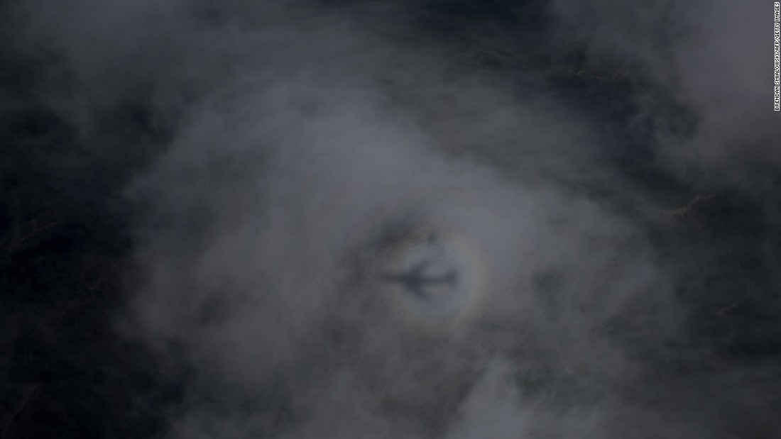 Air Force One's shadow is seen on clouds as it carries President Obama to Oregon on Friday, October 9.