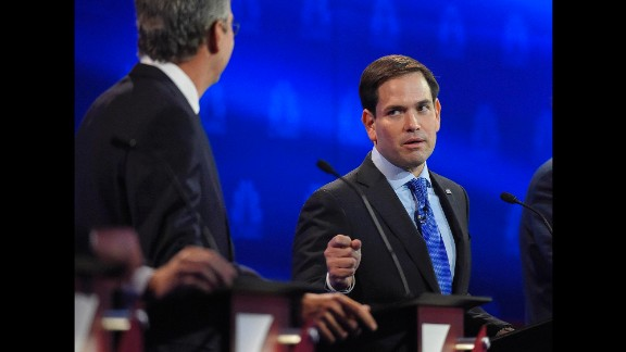"""U.S. Sen. Marco Rubio, right, argues with Jeb Bush during a Republican debate in Boulder, Colorado, on Wednesday, October 28. Bush went after Rubio for missing votes in the Senate while running for the White House. """"Just resign and let someone else take the job,"""" Bush said. Rubio fired back, saying Bush never took issue with Sen. John McCain missing votes when he was running for President. """"The only reason you"""