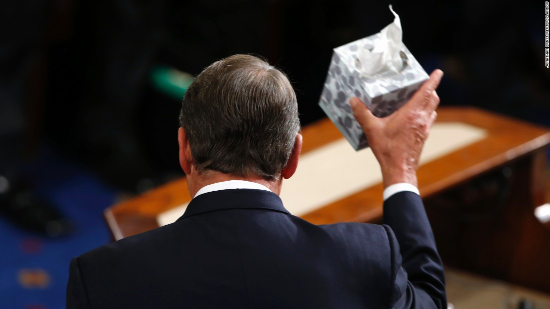 House Speaker John Boehner waves his trademark box of tissues as he addresses colleagues before stepping down on Thursday, October 29.