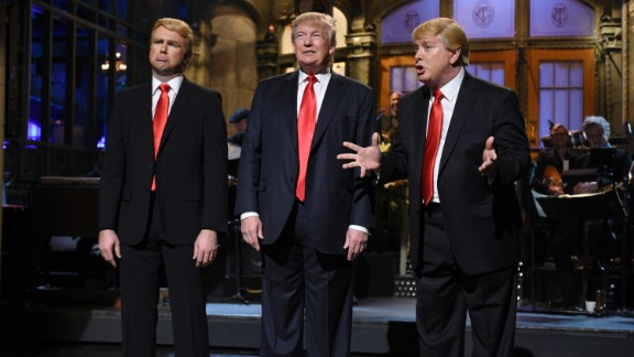 """Republican presidential candidate Donald Trump is flanked by impersonators Taran Killam, left, and Darrell Hammond during his """"Saturday Night Live"""" monologue on November 7."""